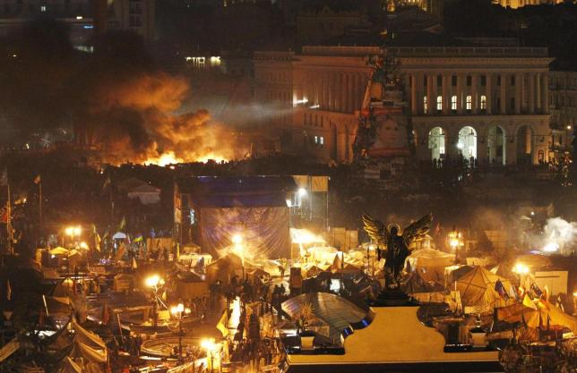 File photo of smoke rising above burning barricades at Independence Square during anti-government protests in Kiev